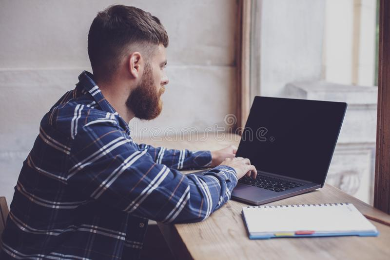 Young man chatting via net-book during work break in coffee shop royalty free stock photo