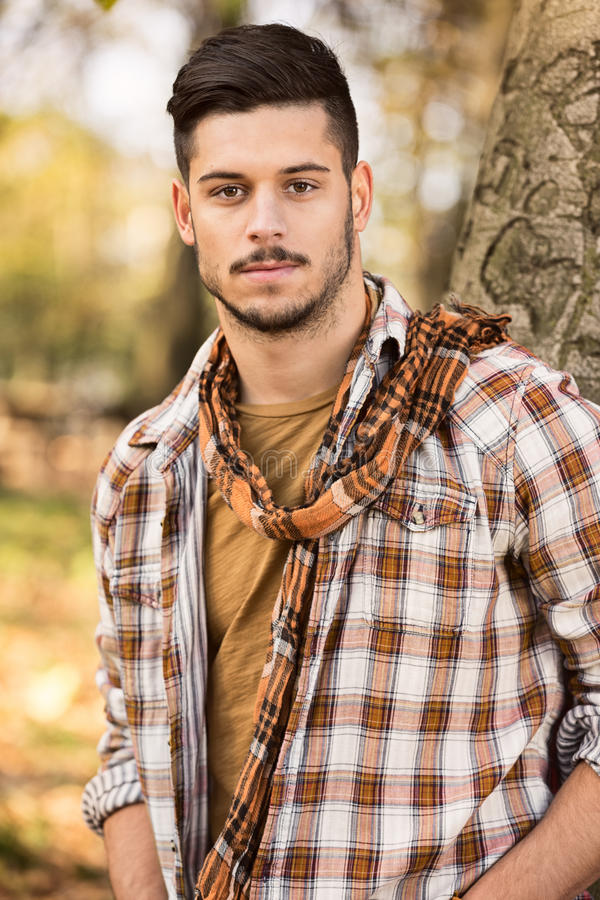 Young man in a checkered shirt royalty free stock image
