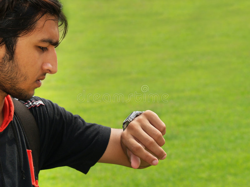 Download Young Man Checking The Time Stock Image - Image of closeup, close: 4033631