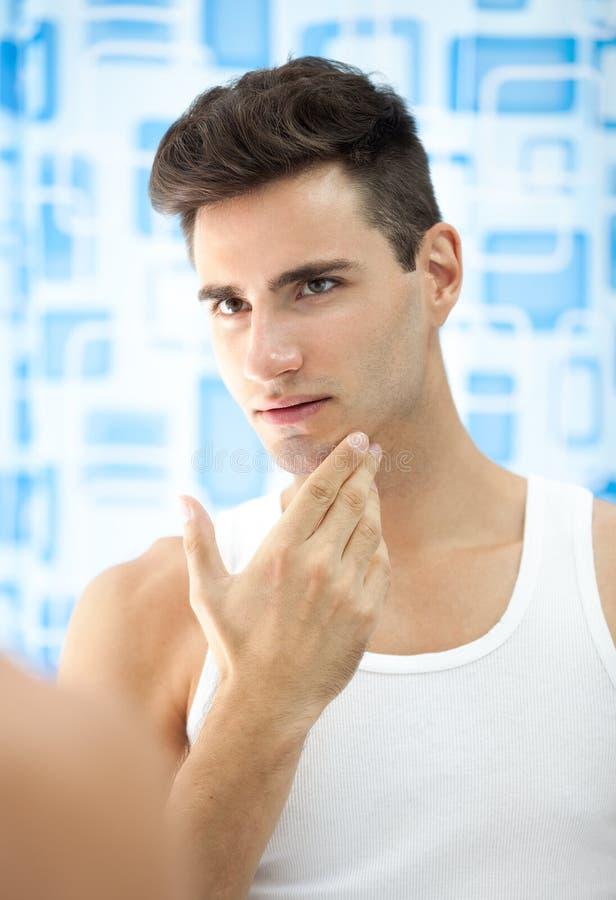 Young man checks his beard