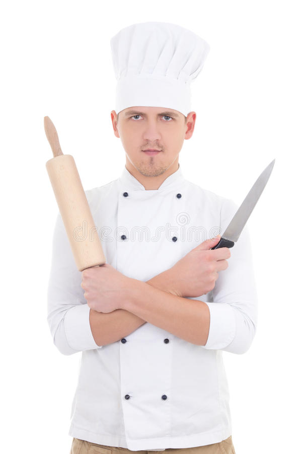 young man in chef uniform with wooden baking rolling pin and knife isolated on white royalty free stock images