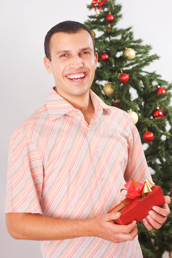 Young man with christmas present royalty free stock photos