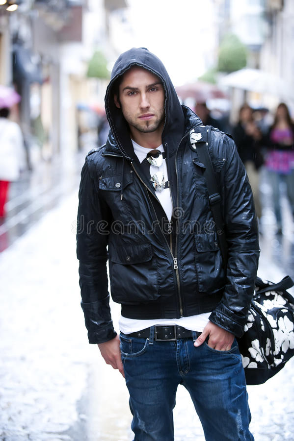 Young man in the city stock photography