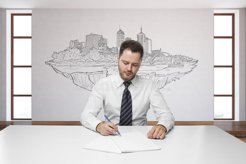 Young man with city sketch royalty free stock images