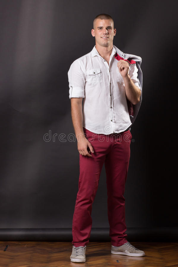 Young man classic posing portrait standing 20 years old pants sh. Irt casual stock photo