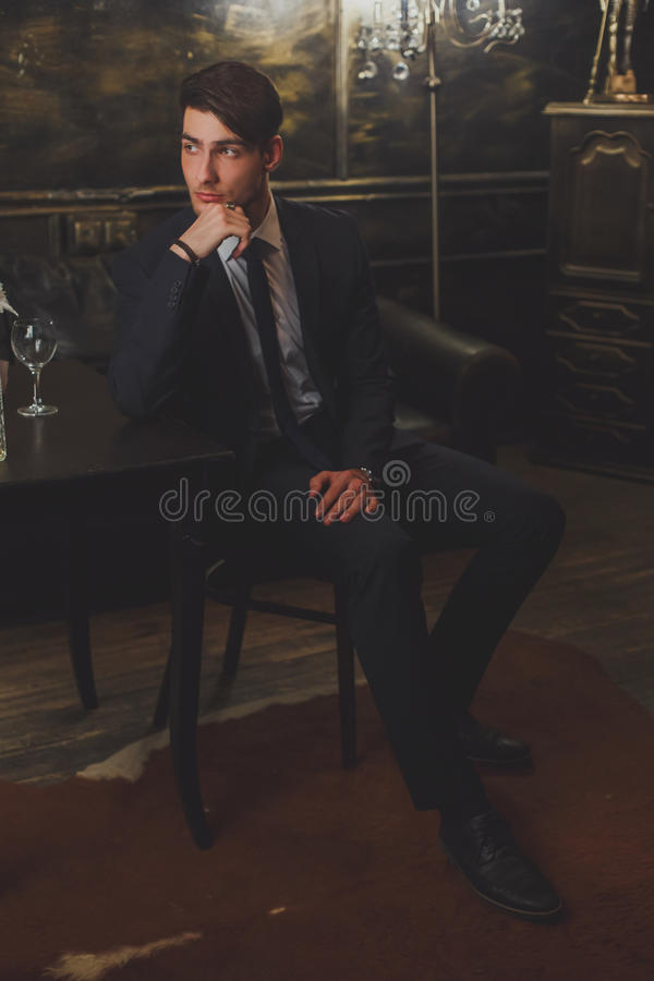 A young man in a classic suit and tie. stock photography