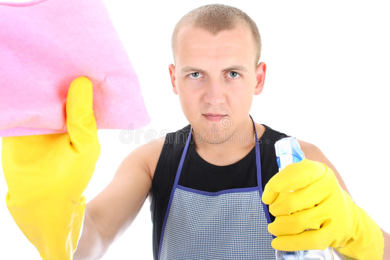 Young man cleaning stock images
