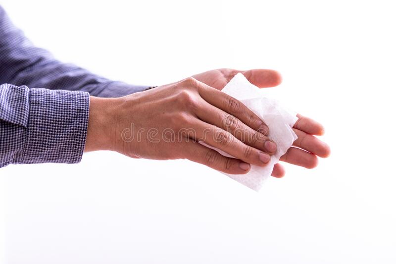 Man cleaning hands with wet wipes stock image