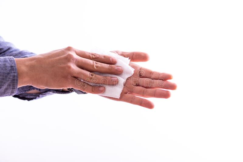 Man cleaning hands with wet wipes stock photo