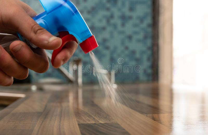 Young man cleaning his kitchen stock photo