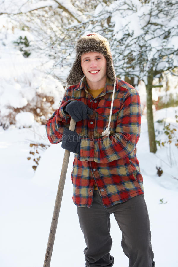 Download Young man clearing snow stock photo. Image of shovelling - 21399076