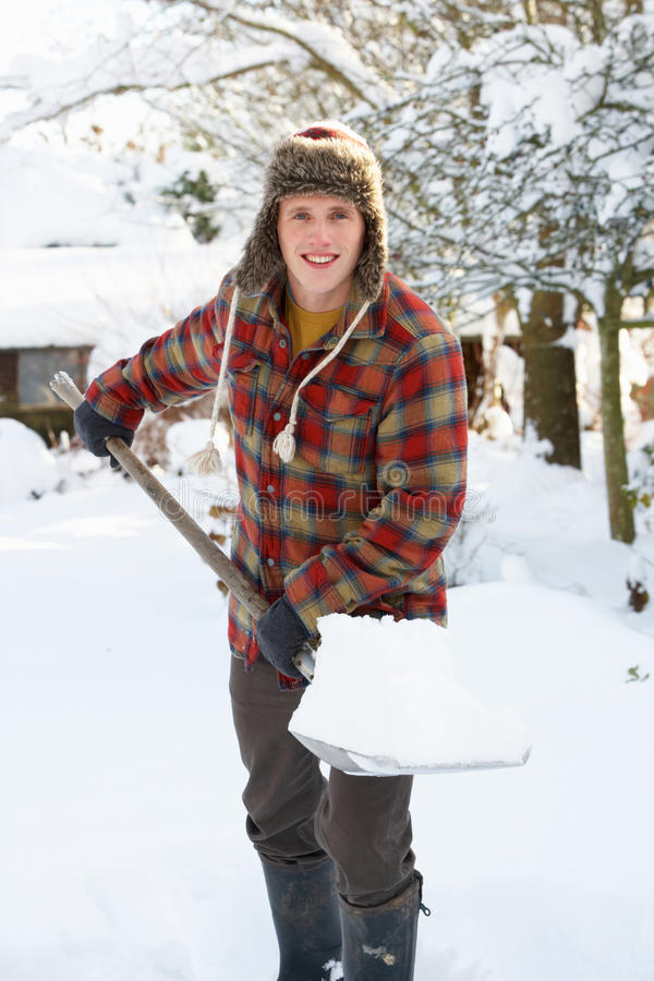 Download Young man clearing snow stock image. Image of snowed - 21399187