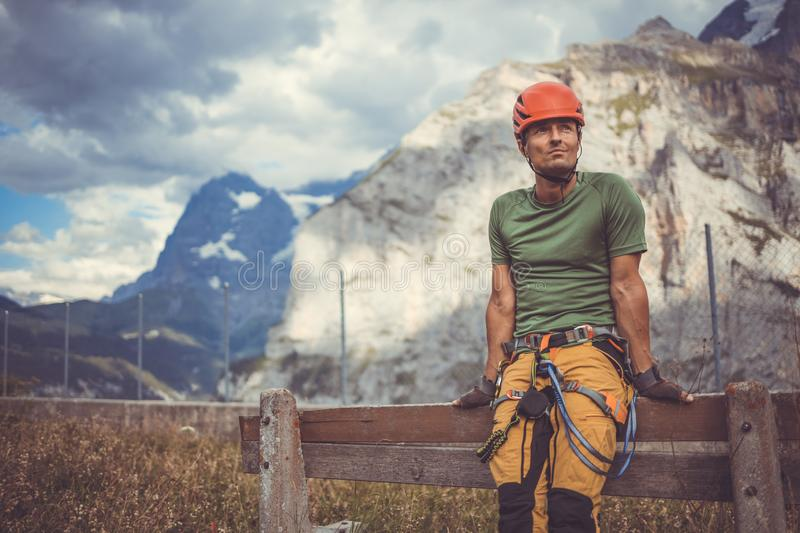 Young man climbing on a rock in Swiss Alps stock photos