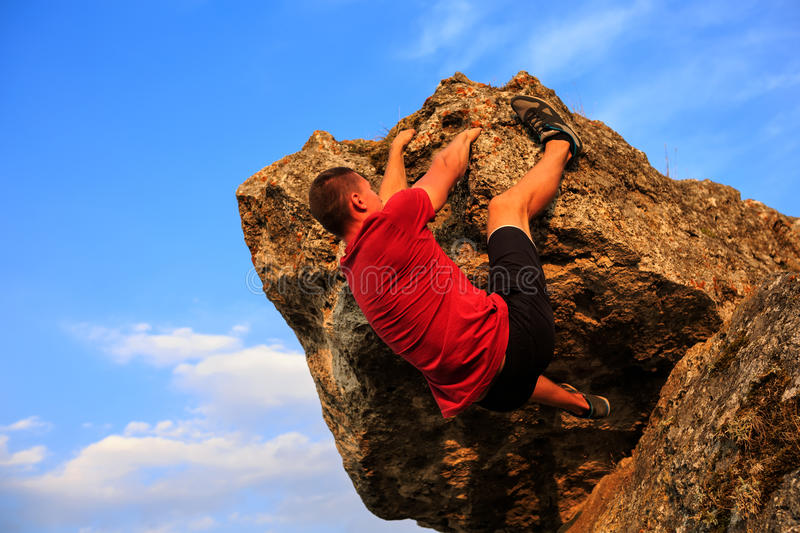 Young man climbing on a wall royalty free stock images