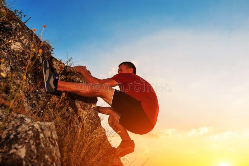 Young man climbing on a wall royalty free stock photos