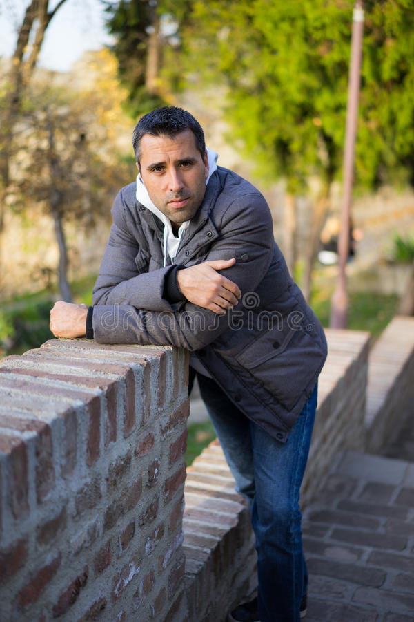 Young Man in Coat Posing royalty free stock images