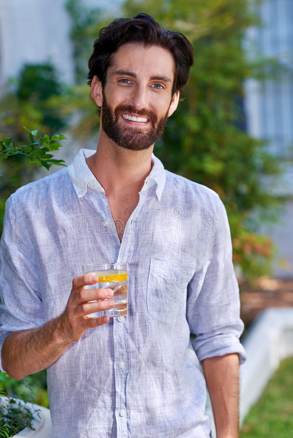 Young man cocktail portrait royalty free stock photography