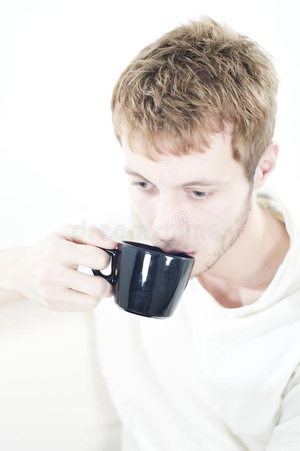 Download Young man with coffee stock photo. Image of drinking - 17918512