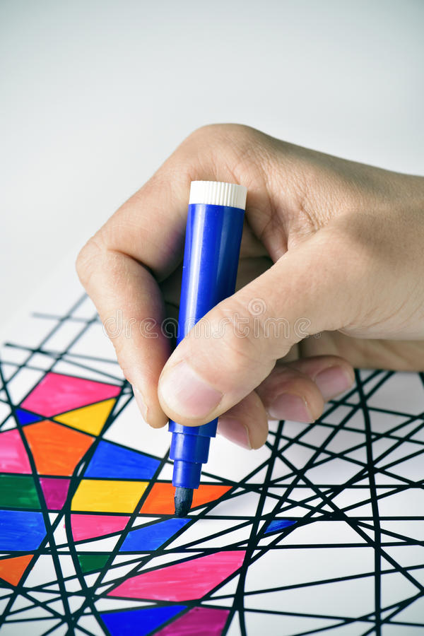 Young man coloring a drawing, designed by myself stock images