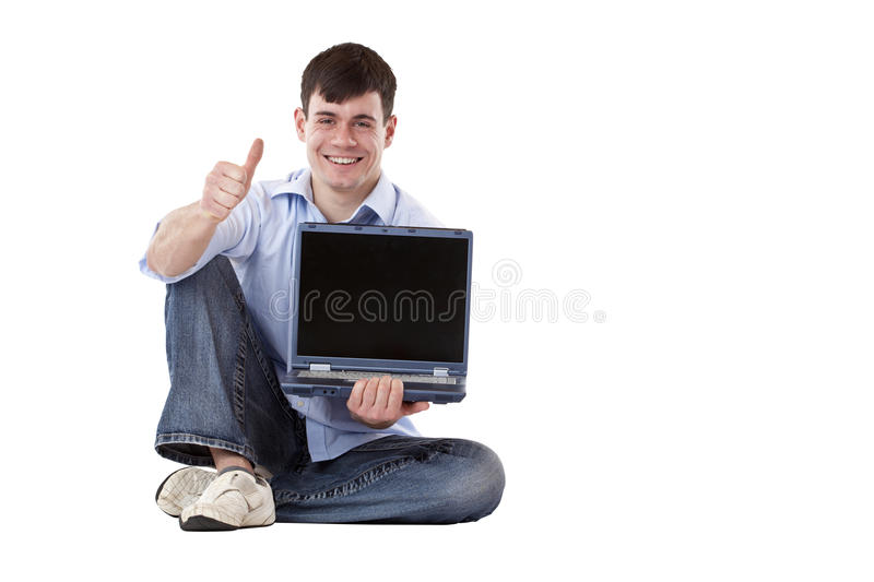 Young man with computer display shows thumb up. Young friendly, casual man with computer display shows thumb up. Isolated on white background royalty free stock photography