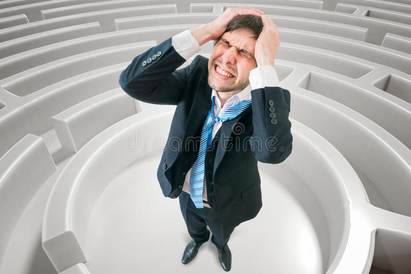 Young man is confused and lost in maze. 3D rendered illustration of maze.  royalty free stock image