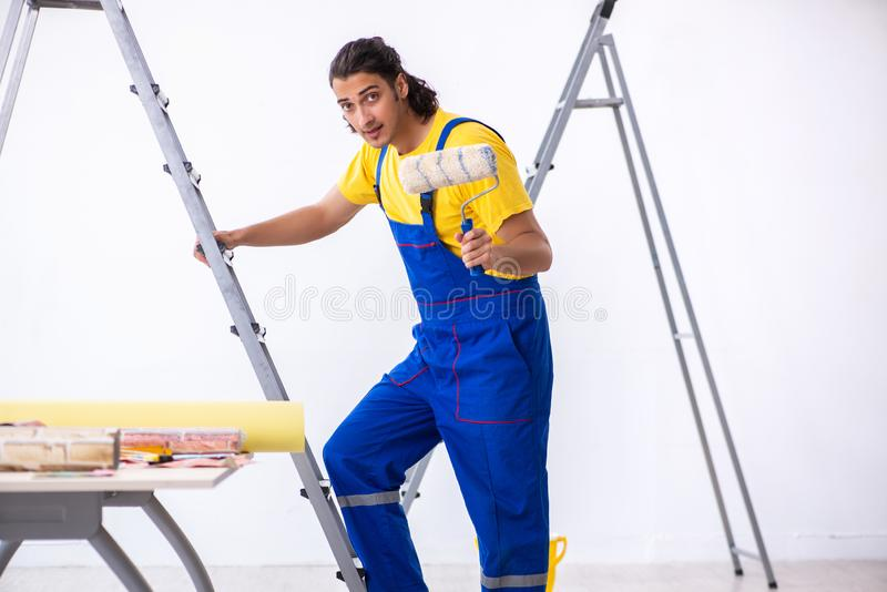 Young man contractor doing renovation at home royalty free stock image