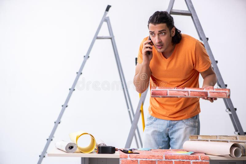 Young man contractor doing renovation at home. The young man contractor doing renovation at home stock images