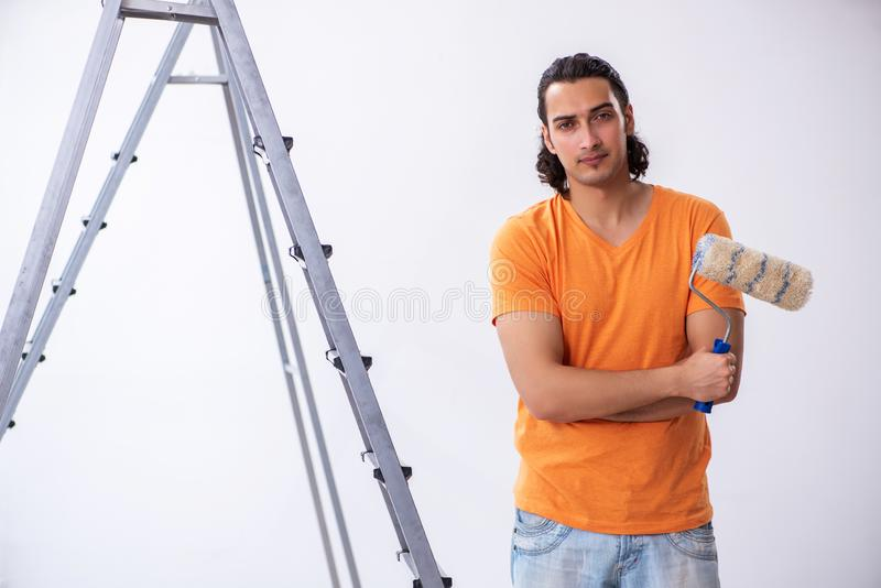 Young man contractor doing renovation at home royalty free stock photo