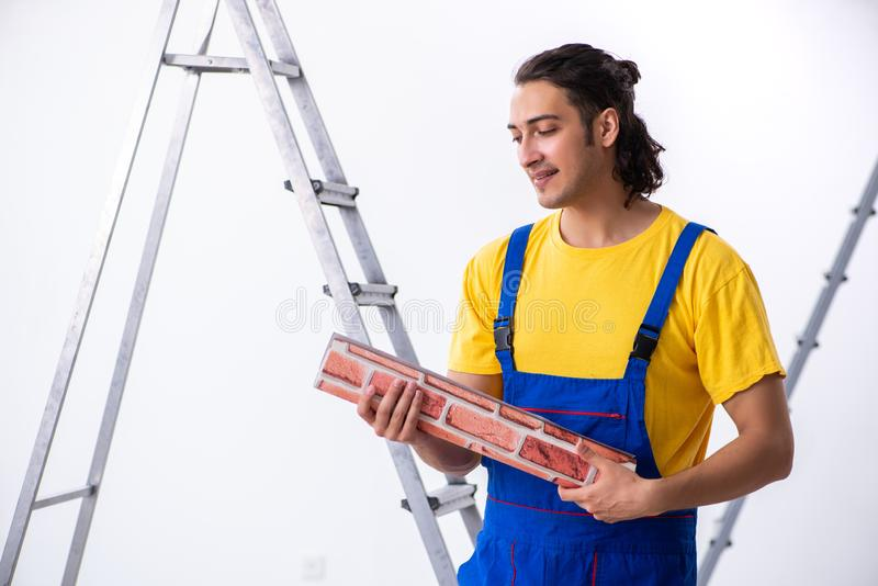 Young man contractor doing renovation at home royalty free stock images