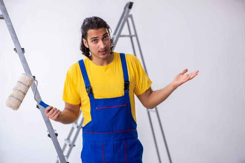 Young man contractor doing renovation at home stock photography