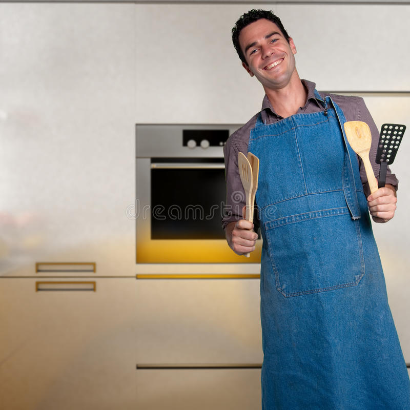 Download Young man cooking stock image. Image of gourmet, oven - 13287761