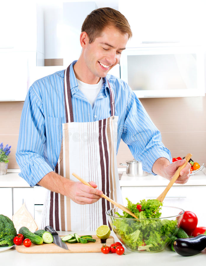 Download Young Man Cooking stock image. Image of flirting, prepare - 27256069