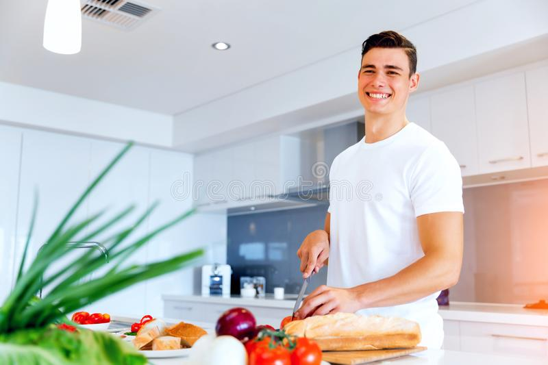 Young man cooking stock photo