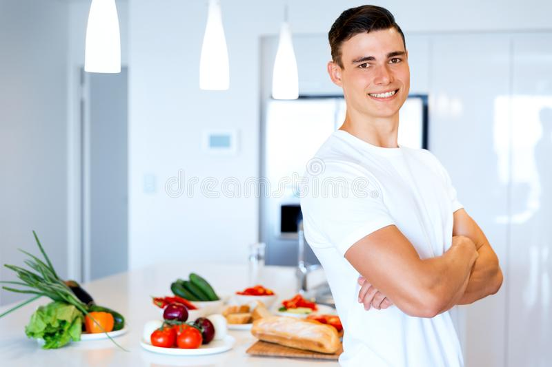 Young man cooking royalty free stock image