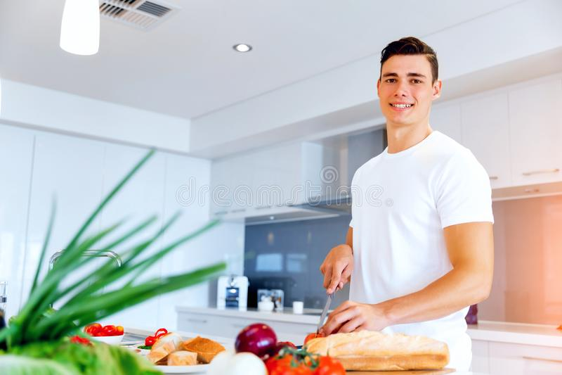 Young man cooking royalty free stock images