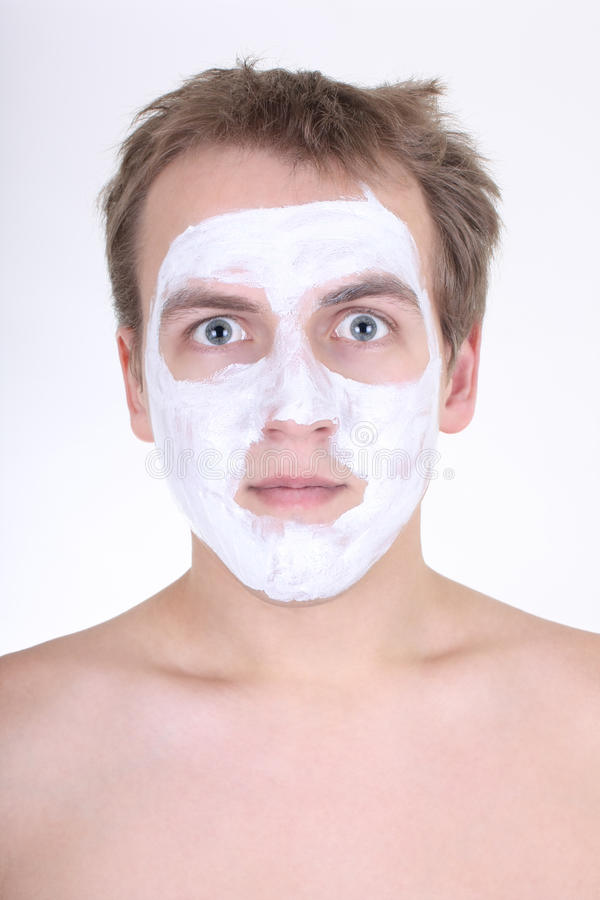 Young man with cosmetic mask on his face