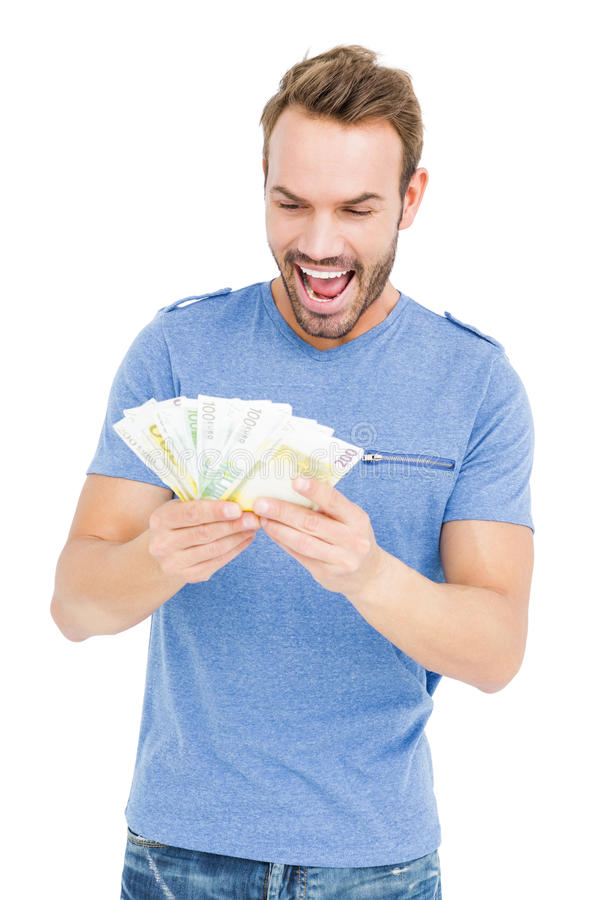 Young man counting currency notes royalty free stock photography