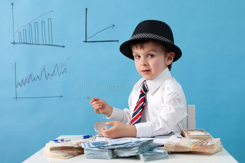 Young man, counting money and taking notes stock image