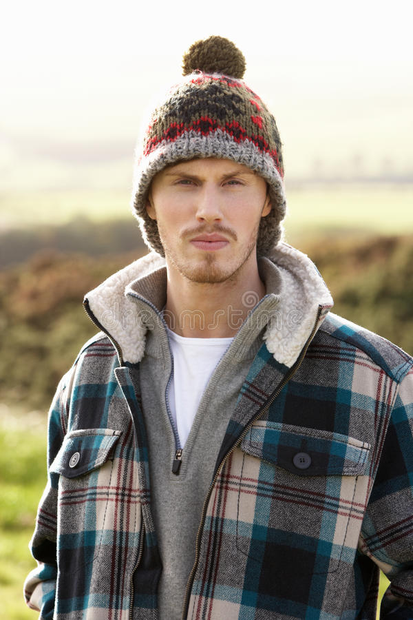 Download Young man in the country stock photo. Image of half, field - 21411912