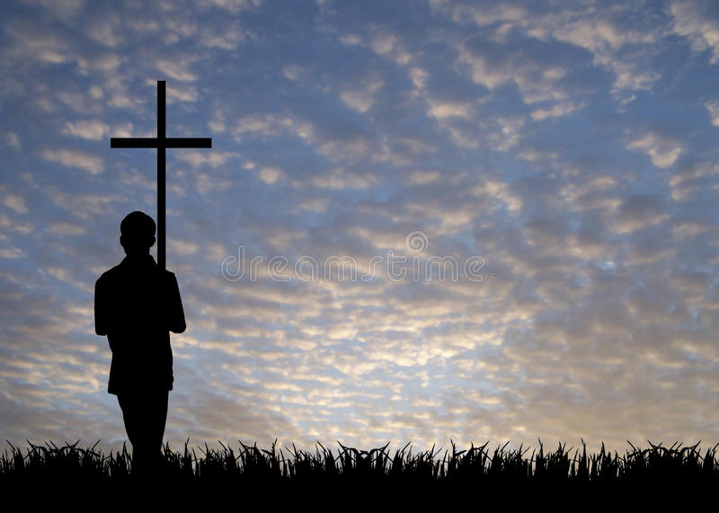 Young man with cross royalty free stock image