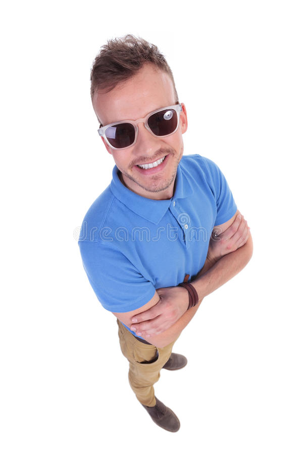 Young man crossing his hands stock photography