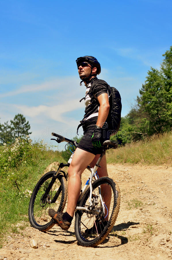 Young man cycling Cross-country stock photo