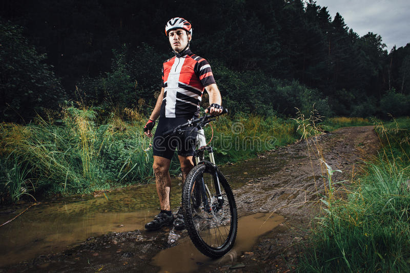 The young man cycling on mountain bike ride Cross-country royalty free stock images