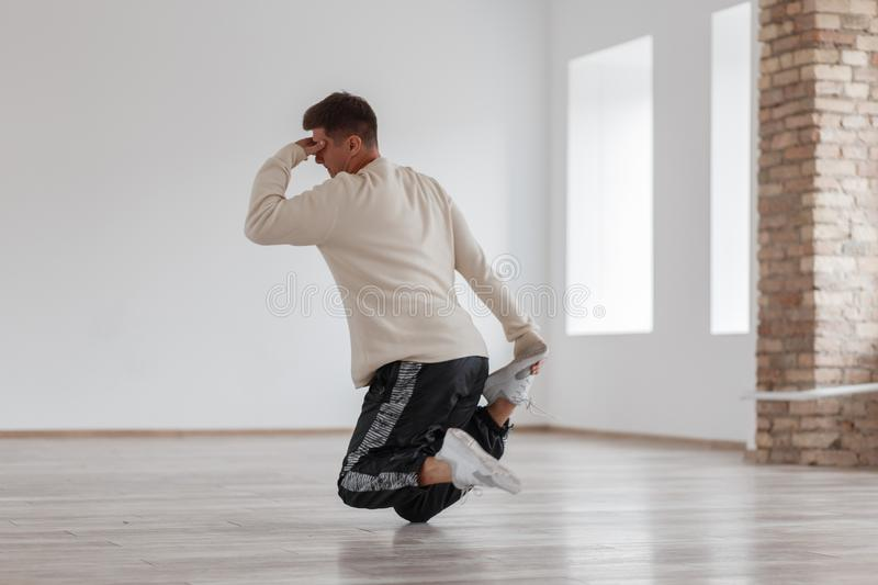A young man dancing break dance standing on his foot stock photo
