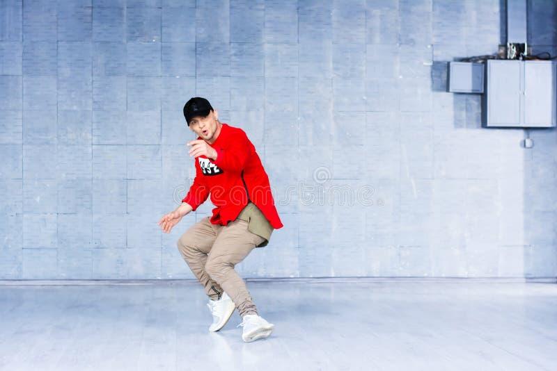 Young man dancing break dance. stock photos