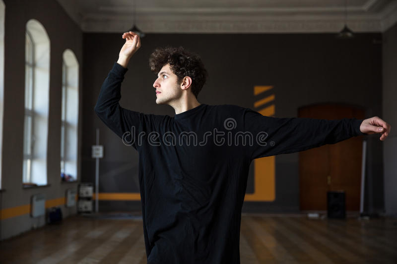 Young man dancing at gym stock photography