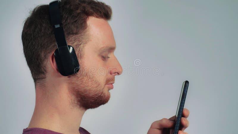 Men listen playlist on smartphone royalty free stock photography