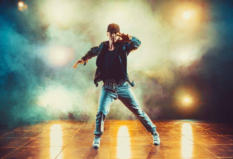 Young man dancing stock photos