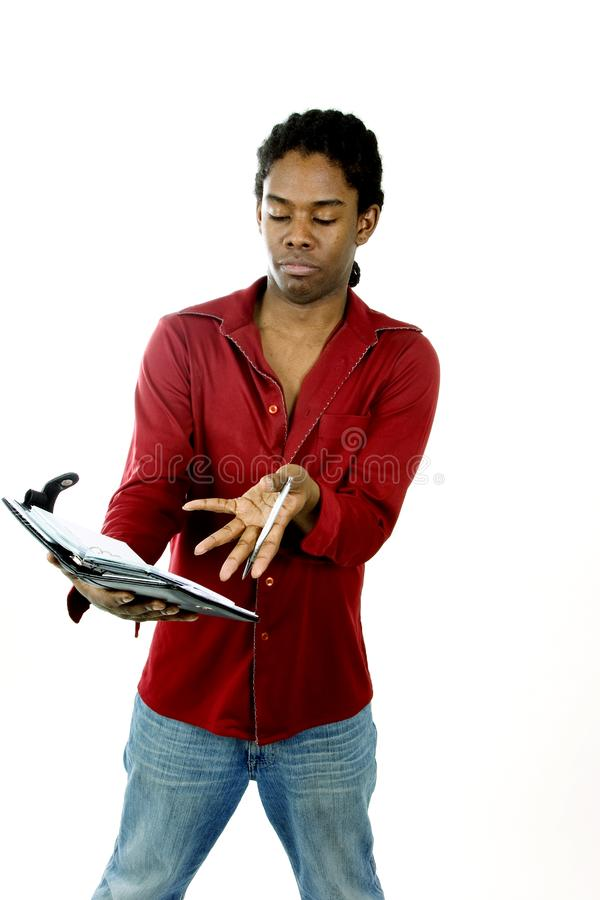 Download Young man with day planner stock image. Image of attention - 650485