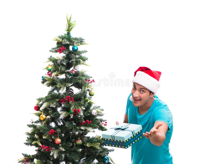 Young man decorating christmas tree isolated on white. The young man decorating christmas tree isolated on white royalty free stock images